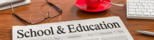 Education Industry - Newspaper that says school & education on it.